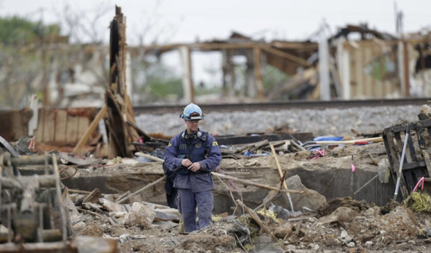 An investigator looks over a destroyed fertilizer plant in West, Texas.