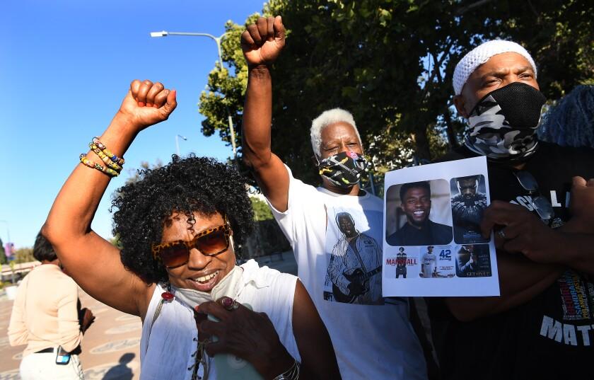 "Fans of Chadwick Boseman chant ""Wakanda forever"" at Leimart Park Saturday."