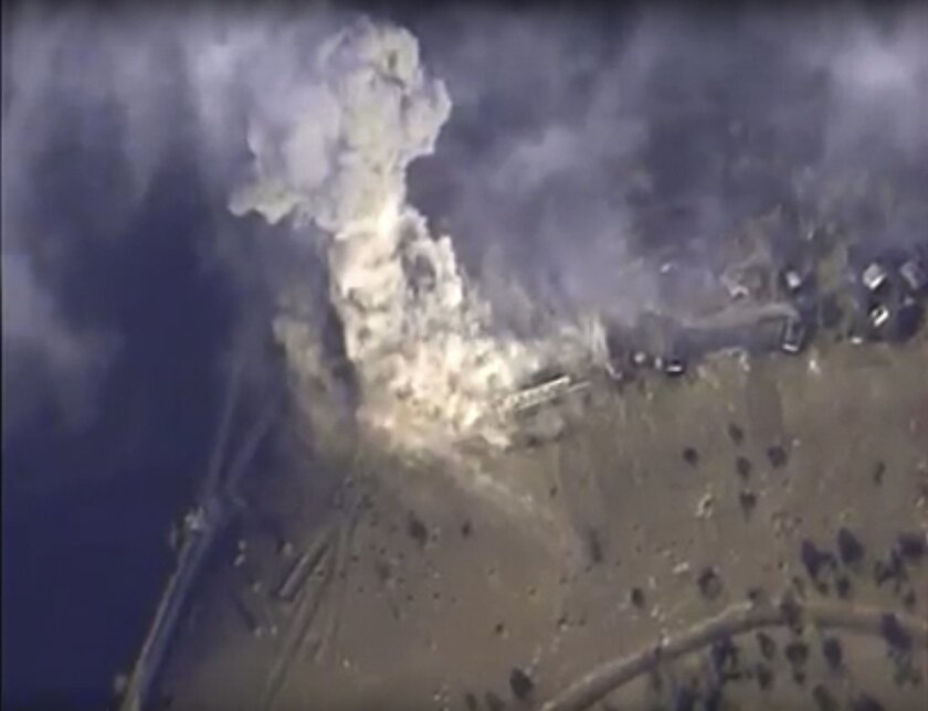 This photo made from the footage taken from Russian Defense Ministry official web site on Monday, Nov. 2, 2015 shows a target hit during s Russian air raid in Syria. Russian Defense Ministry said the strike was performed by an Su-34M bomber in Aleppo province. (AP Photo/ Russian Defense Ministry Pr