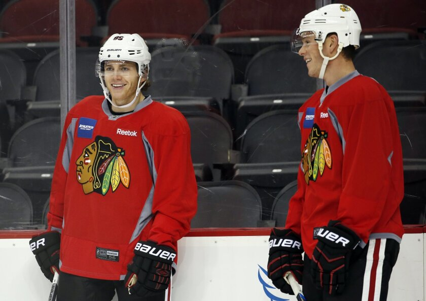 Chicago Blackhawks' Patrick Kane, left, stands next to Jonathan Toews while working out during a morning skate prior to facing the New Jersey Devils, Friday, Nov. 6, 2015, in Newark, N.J. Prosecutors announced Thursday, Nov. 5, 2015, that they will not bring rape charges against Kane, citing a lack