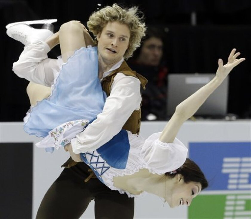 Meryl Davis and Charlie White, of the United States, perform during the ice dance short dance at the World Figure Skating Championships Thursday, March 14, 2013, in London, Ontario. (AP Photo/Darron Cummings) .