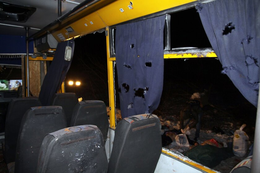 Eleven people were killed when a bus was hit during shelling apparently aimed at a checkpoint manned by Ukrainian forces in Volnovakha, in the eastern region of Donetsk.