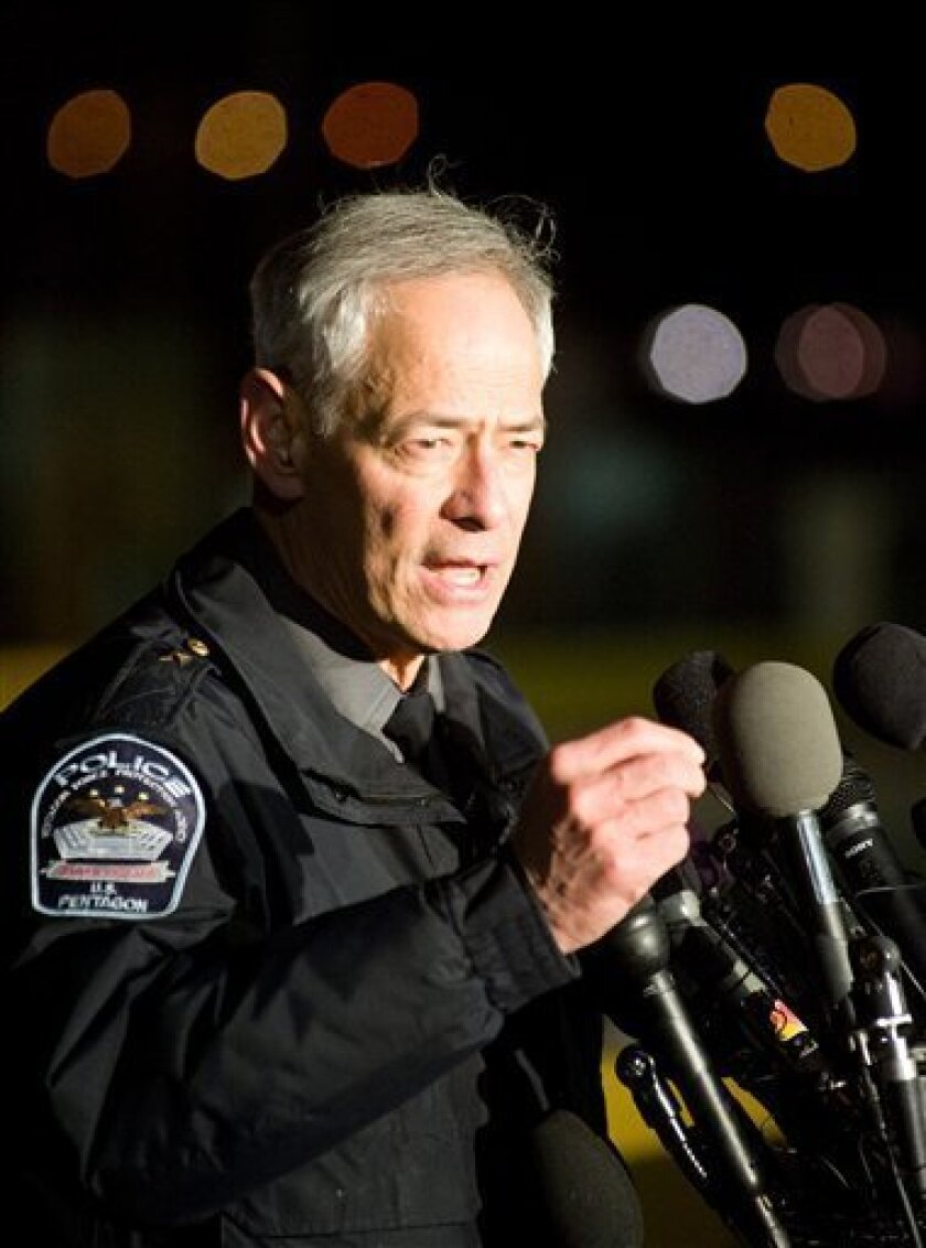 Pentagon Police Chief Richard Keevill speaks with reporters about a shooting at the Pentagon in Washington, Thursday, March 4, 2010. A gunman coolly drew a weapon from his pocket and opened fire at the teeming subway entrance to the Pentagon complex, wounding two police officers before being shot and critically wounded, officials said. (AP Photo/Cliff Owen)