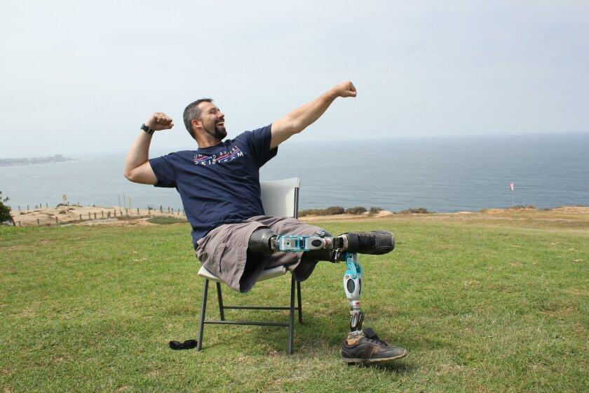 Retired marine sergeant Joshua Elliot shows excitement about gliding around the La Jolla skies.