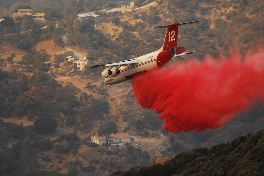 Planes drop retardant on the Cave fire.