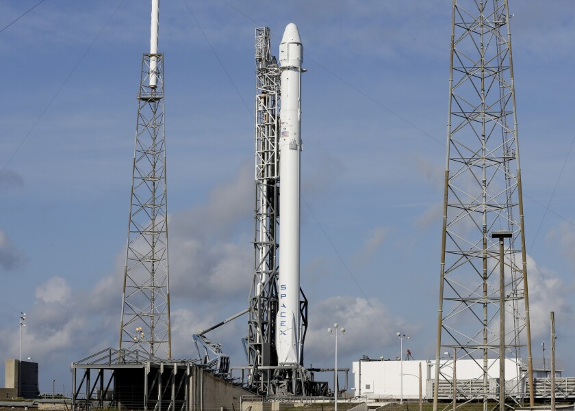 After a scrub on Monday, the Falcon 9 SpaceX rocket stands ready for another launch attempt at complex 40 at the Cape Canaveral Air Force Station in Cape Canaveral, Fla., Tuesday, April 14, 2015.