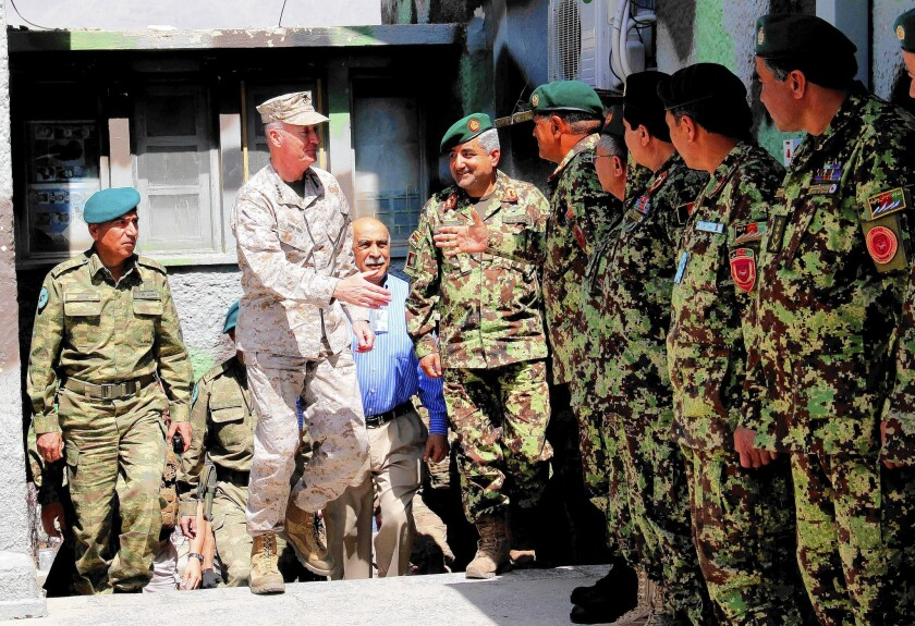 U.S. Marine Corps Gen. Joseph F. Dunford Jr. meets with Afghan army officers in Kabul. Dunford hopes to persuade the CIA to remain in Afghanistan until at least October, a U.S. official said.