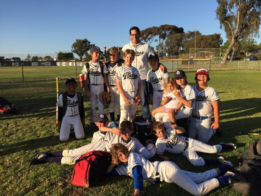 The La Jolla Community Foundation team managed by John Dobak takes a photo after the game May 2.