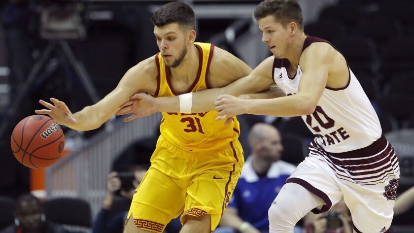Missouri State's Ryan Kreklow (20) tries to steal the ball from USC's Nick Rakocevic (31) during the first half on Nov. 20 in Kansas City, Mo.