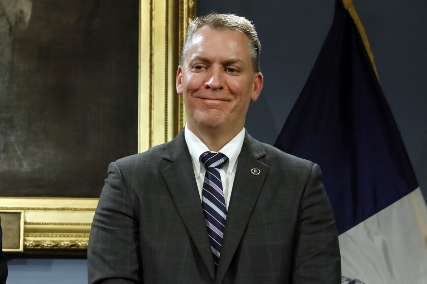 FILE - In this Nov. 4, 2019 file photo New York City Police Department Chief of Detectives Dermot Shea smiles during a news conference at New York's City Hall. Shea, appointed Monday as New York City's next police commissioner, is taking over at an uneasy time for the nation's largest police department. Shea, who succeeds James O'Neill on Dec. 1, will have to contend with looming bail and other criminal justice reforms, pressure to reduce arrests and incarcerations ahead of the planned 2026 closure of the city's notorious Rikers Island jail complex, and dissent among the department's officers. (AP Photo/Richard Drew, File)
