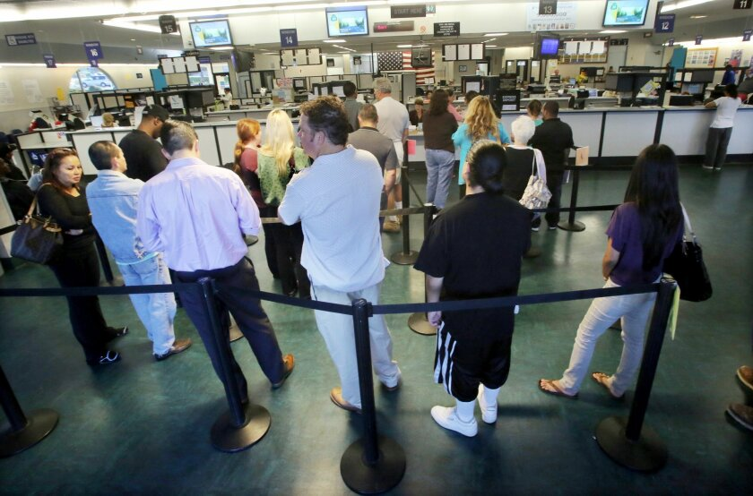 People waiting in line for service at the Department of Motor Vehicles office in Oceanside last year. Officials expect a surge in new license applications from unauthorized immigrants after passage of a new state law.