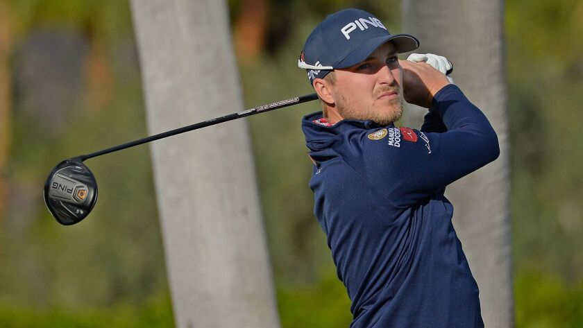 Austin Cook tees off on the first hole during the third round of the CareerBuilder Challenge at La Quinta Country Club on Saturday.