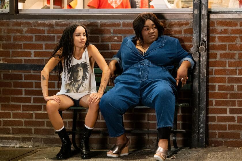 "Zoë Kravitz and Da'Vine Joy Randolph in the Hulu series ""High Fidelity."""