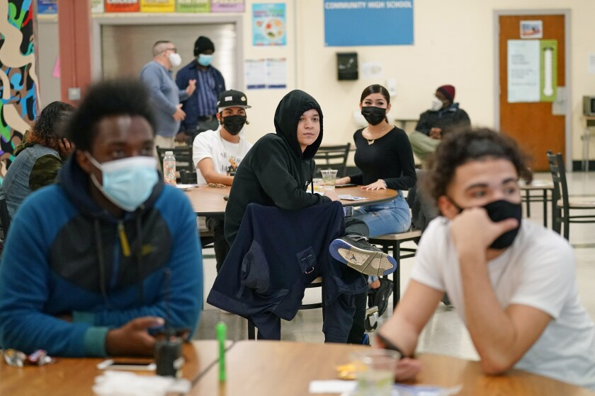 Students at West Brooklyn Community High School in New York listen to their principal in the school's cafeteria on Oct. 29.