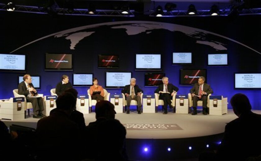 From left, Senior Managing Editor for the Associated Press Michael Oreskes, Chairman of the Management Board of Deutsche Bank, Josef Ackermann, Chairman and CEO of Archer Daniels Midland, USA, Patricia Woertz, Chairman of Wipro, India, Azim Primji, Group Chief Executive of Standard Chartered Bank, UK, Peter Sands and Chairman and CEO of Aetna, USA, Ronald Williams during a session 'A Roadmap to Sustainable Recovery' at the World Economic Forum in Davos, Switzerland on Sunday, Jan. 31, 2010. (AP Photo/Virginia Mayo)