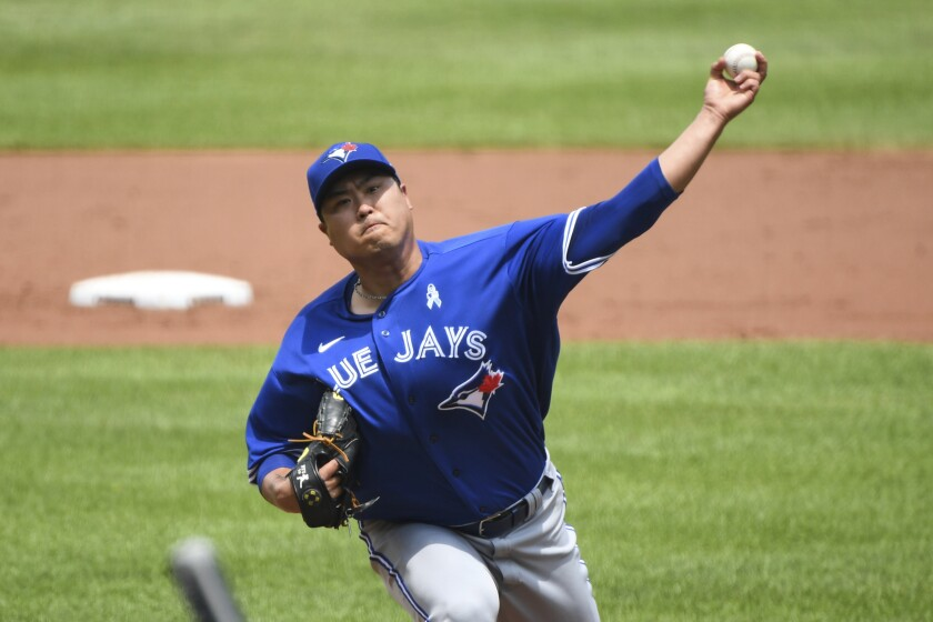 Toronto Blue Jays starting pitcher Hyun Jin Ryu throws a pitch during the first inning of a baseball game against the Baltimore Orioles, Sunday, June 20, 2021, in Baltimore. (AP Photo/Terrance Williams)