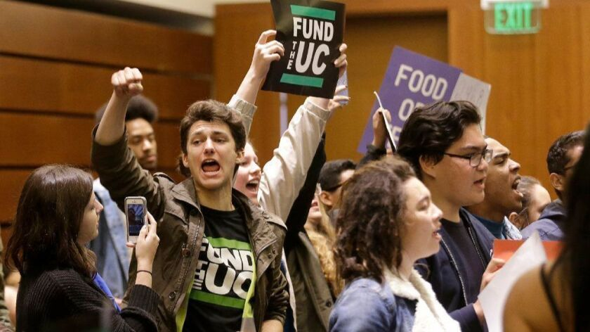 Students protest tuition hikes at a 2016 University of California Board of Regents meeting in San Francisco.