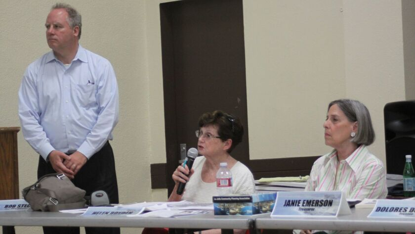 LJCPA acting chair Bob Steck (standing) and trustees Helen Boyden and Janie Emerson ask questions ab