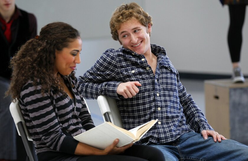 "Kathleen Calvin (left) and Chris Murphy rehearse the play ""A Day in the Life."" The production is a part of the annual Festival of Plays by Young Writers, which kicks off Feb. 1 at Lyceum Theatre."