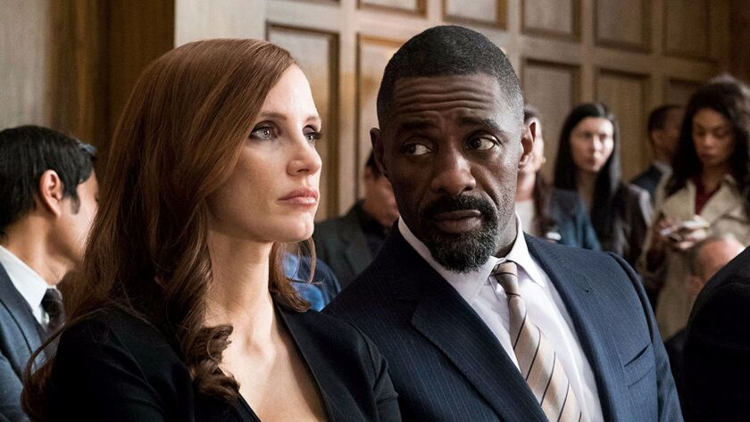 "Idris Elba and Jessica Chastain in the movie ""Molly's Game."""