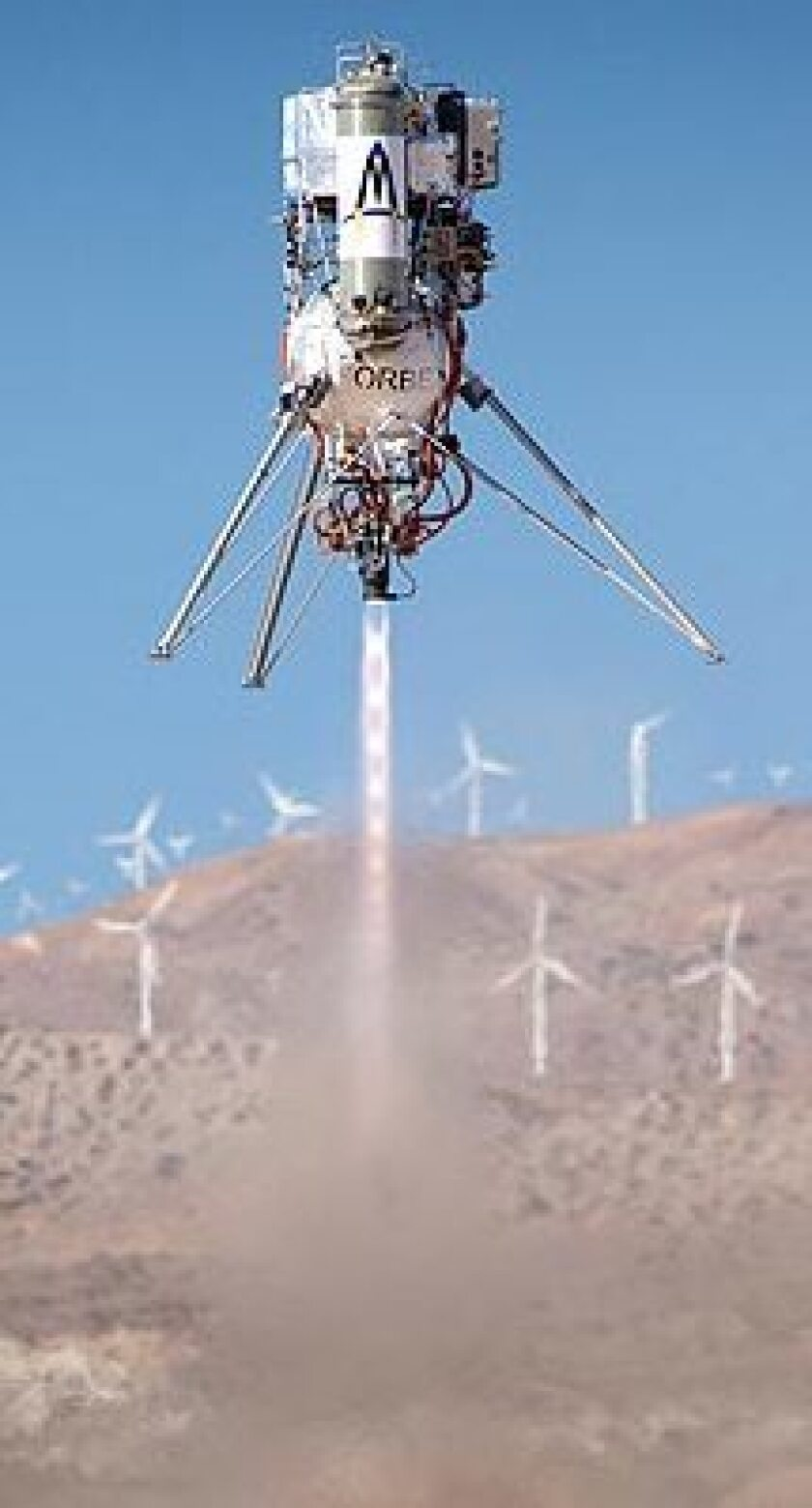 The Masten Space Systems rocket lifts off from the launchpad Friday. The effort appeared to move Masten into the lead of the $2-million Northrop Grumman Lunar Landing Challenge.