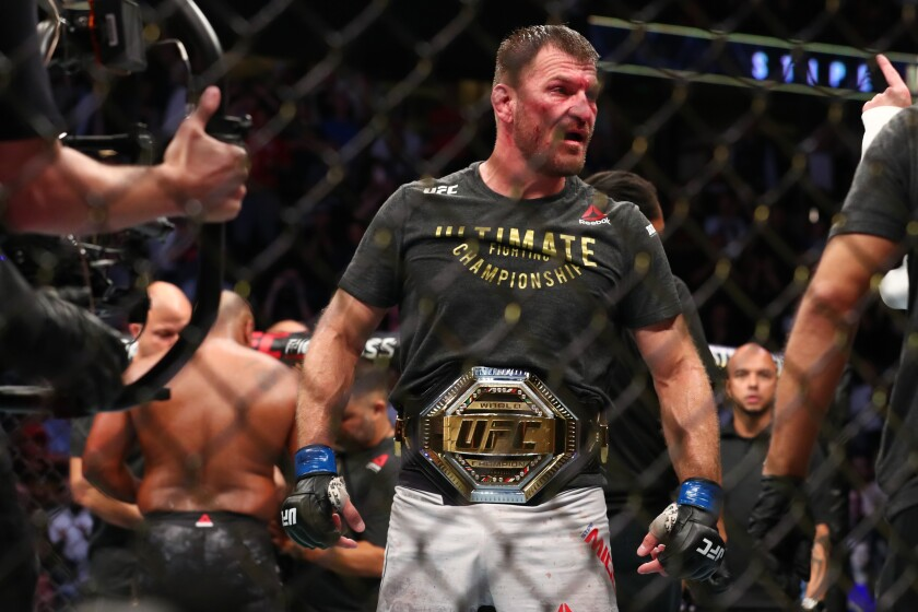 Stipe Miocic celebrates his win over Daniel Cormier after their UFC Heavyweight Title Bout at UFC 241 at Honda Center on Saturday.
