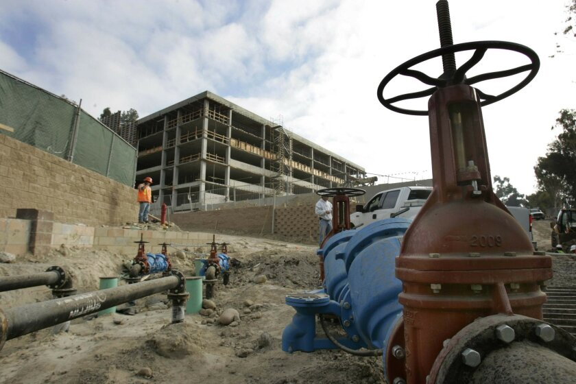 An apartment complex ahead of its time? The 260-unit development under construction near San Diego State University will install submeters, which will track each tenant's water use and allow for individual billing. (John Gibbins / Union-Tribune)