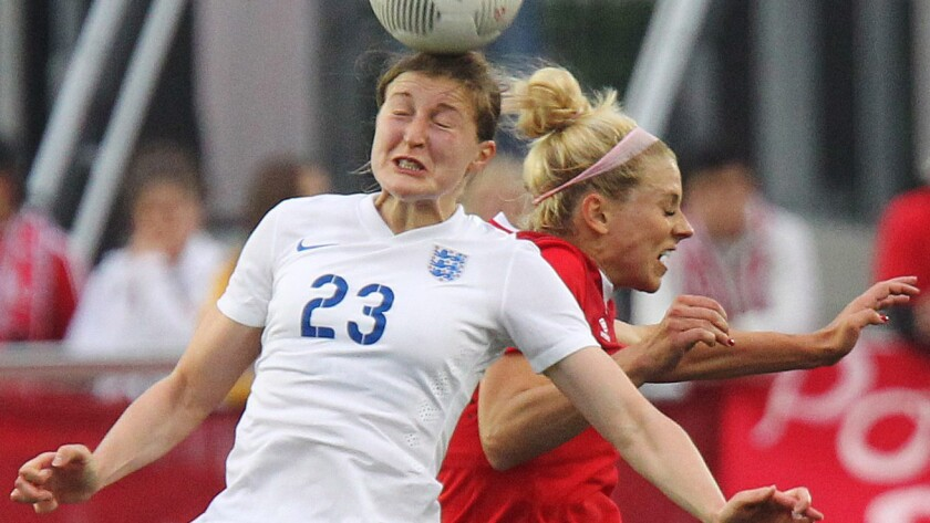 England's Ellen White, left, heads the ball in front of Canada's Lauren Sesselmann during an international friendly in Hamilton, Canada, on Friday.