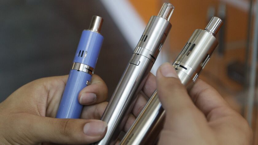 Health officials say they want more federal action on Big Tobacco and the e-cigarette industry. Above, e-cigarettes for sale at a Sacramento store.