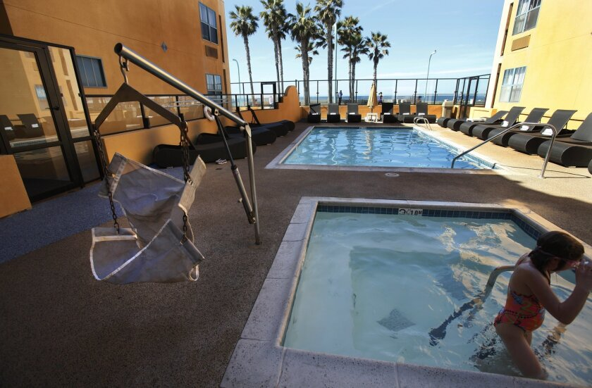 The Ocean Park Inn in Pacific Beach has a portable pool lift for the disabled, but new federal regulations require a permanently attached device.