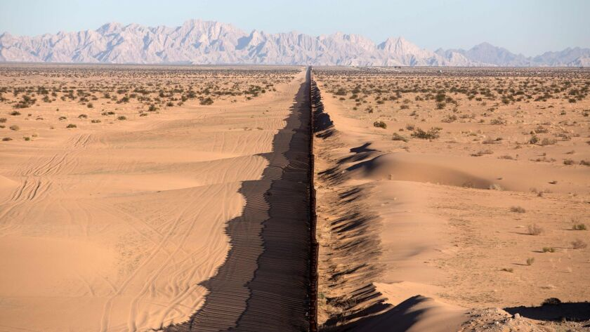 A portion of the U.S.-Mexico border is seen south of Yuma, Ariz.