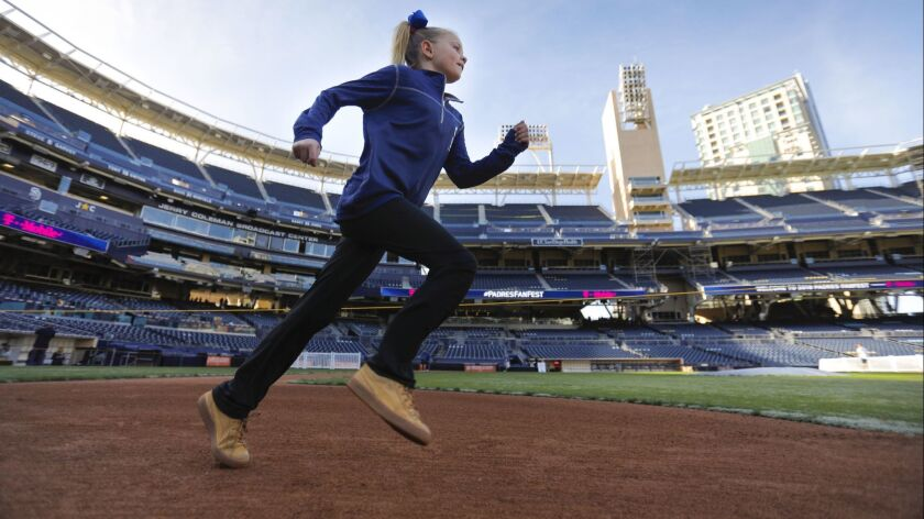 Nine-year-old Bailee Stevens of Fallbrook was one of the first to run the bases during the 2018 Padres FanFest at Petco Park on Jan. 13, 2018.