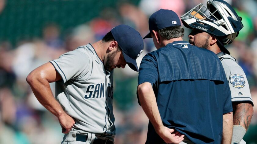 Padres starting pitcher Jarred Cosart, left, confers with pitching coach Darren Balsley, center, and catcher Hector Sanchez after walking the Rockies' Charlie Blackmon to load the bases in the fourth inning of a baseball game Sunday, Sept. 18, 2016, in Denver.