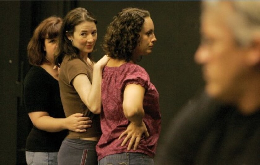 "Melissa Fernandes (top, left), Jo Anne Glover and Morgan Trant in rehearsal for Moxie's ""Drink Me, or The Strange Case of Alice Times Three."""