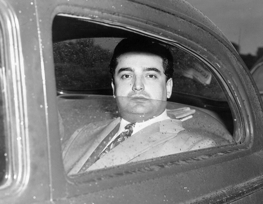 Harry Gross leaves Special Sessions Court on December 4, 1950.