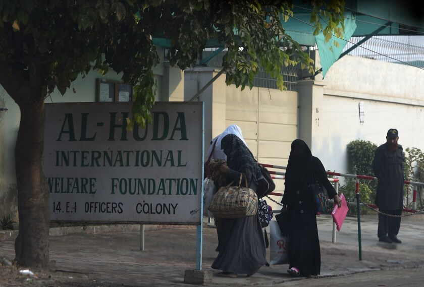 Pakistani students arrive Monday at Al Huda, a women-only seminary in Multan, Pakistan, where San Bernardino shooter Tashfeen Malik studied.