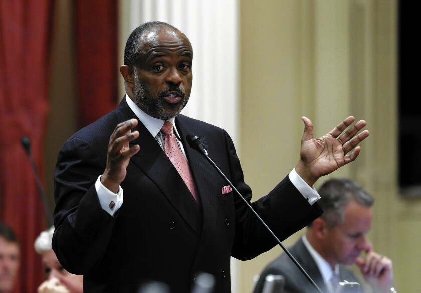 State Sen. Roderick Wright (D-Inglewood), photographed at the Capitol in September, will remain a member of California's upper house until an appeal is decided on his eight felony convictions for lying about where he lived.