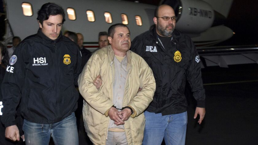 "Authorities escort Joaquin ""El Chapo"" Guzman from a plane to a waiting caravan after his capture in 2017."