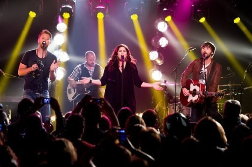 This May 8, 2013 photo released by iHeartRadio shows members of the band Lady Antebellum, from left, Charles Kelley, Hillary Scott, and  Dave Haywood during a performance in New York. The intimate show was part of iHeartRadio Live, a Clear Channel entertainment production that features performances