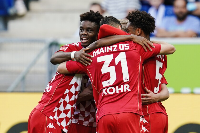 Mainz players celebrate their opening goal during a German Bundesliga soccer match between TSG 1899 Hoffenheim and FSV Mainz 05 in Sinsheim, Germany, Saturday, Sept.11, 2021. (Uwe Anspach/dpa via AP)