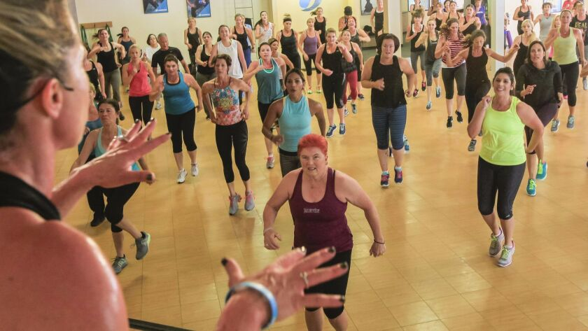 Students at a Jazzercise studio in Oceanside enjoy a Dance Mixx class in February 2015.