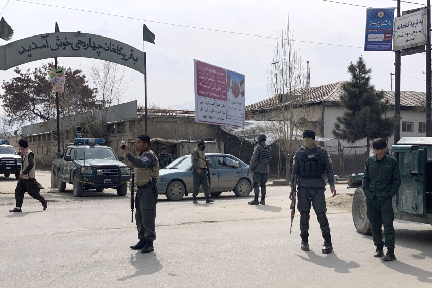 Afghan security personnel arrive at the site of an attack in Kabul, Afghanistan, Friday, March 6, 2020. Gunmen in Afghanistan's capital of Kabul attacked a remembrance ceremony for a minority Shiite leader on Friday, wounding a dozen of people, officials said. (AP Photo/Rahmat Gul)