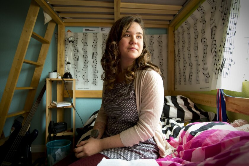 Maya Little-Sana, shown in her room at home, received a prestigious national award with an essay about her dark days.