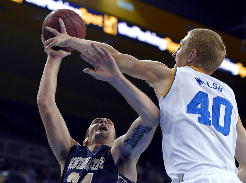 UCLA center Thomas Welsh blocks a shot by Montana State forward Danny Robison in the first half Friday night.