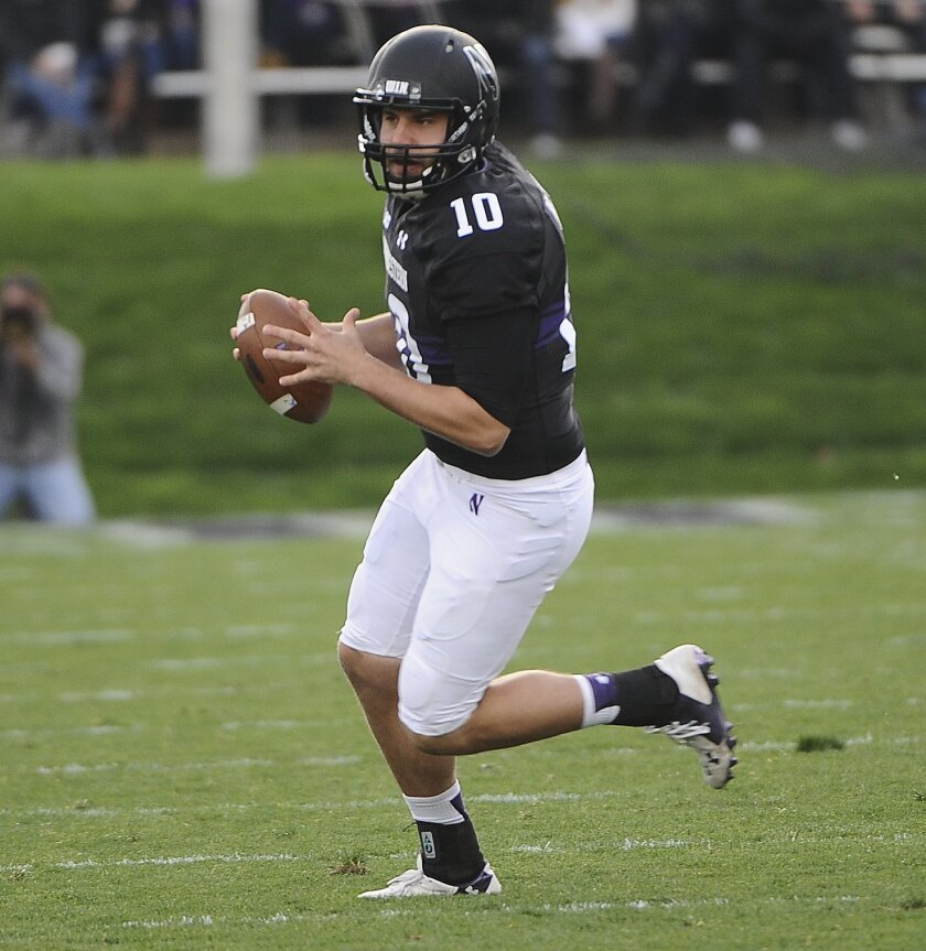Northwestern quarterback Zack Oliver (10) looks to pass against Penn State during the first quarter of an NCAA college football game in Evanston, Ill.,  Saturday, Nov. 7, 2015. (AP Photo/Matt Marton)