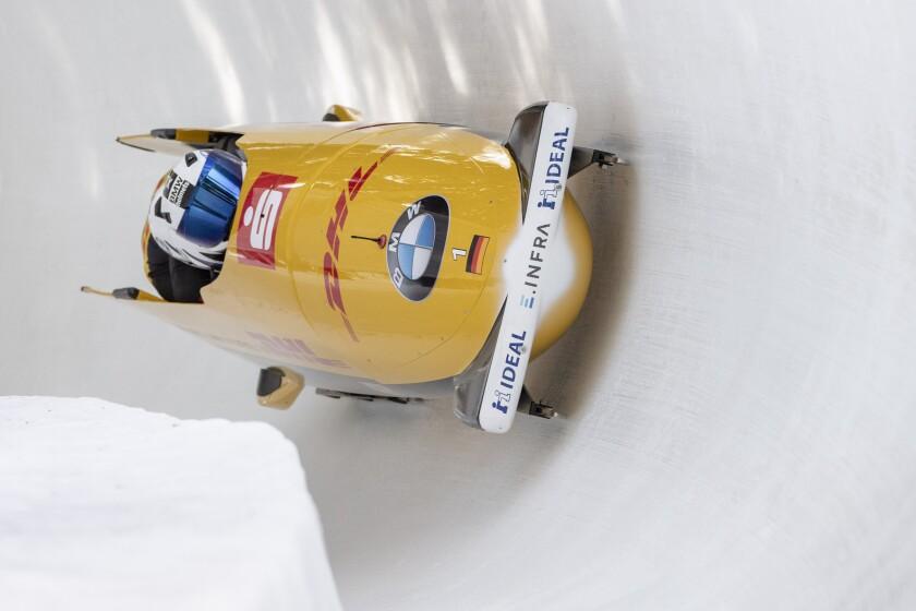 The Team Francesco Friedrich from Germany during the Men four Bob Sledge World Cup in St. Moritz, Switzerland, on Sunday, Feb. 2, 2020. (Urs Flueeler/Keystone via AP)