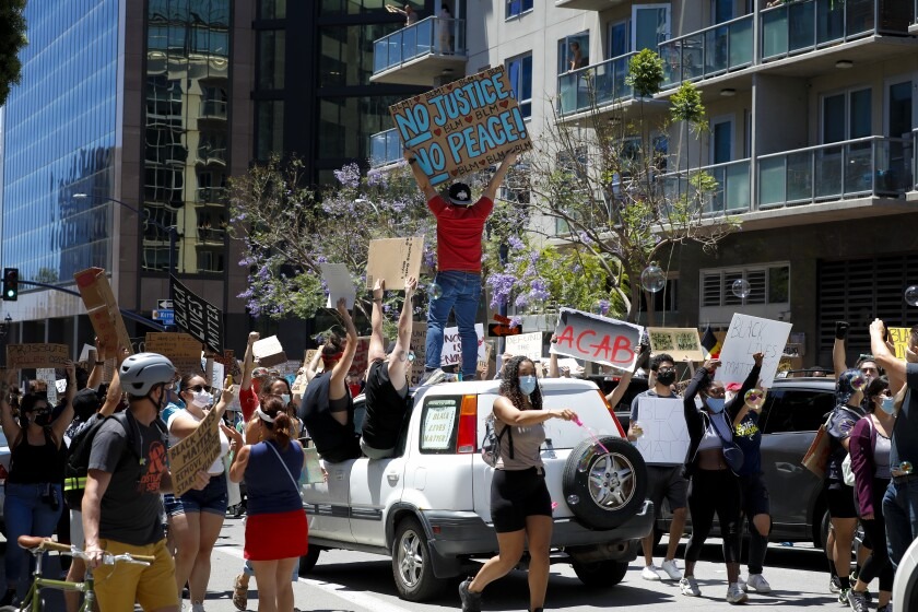 Protesters call for defunding police.