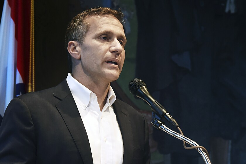 """FILE - In this May 29, 2018, file photo, Missouri Gov. Eric Greitens announces his resignation during a news conference in Jefferson City. An ethics investigation has found that Greitens' campaign cooperated with a political action committee during his successful bid for governor. Missouri Ethics Commission findings released on Thursday, Feb. 13, 2020, say there's """"probable cause"""" to show that Greitens' campaign broke campaign finance law by not publicly reporting that help. (Julie Smith/The Jefferson City News-Tribune via AP, File)"""