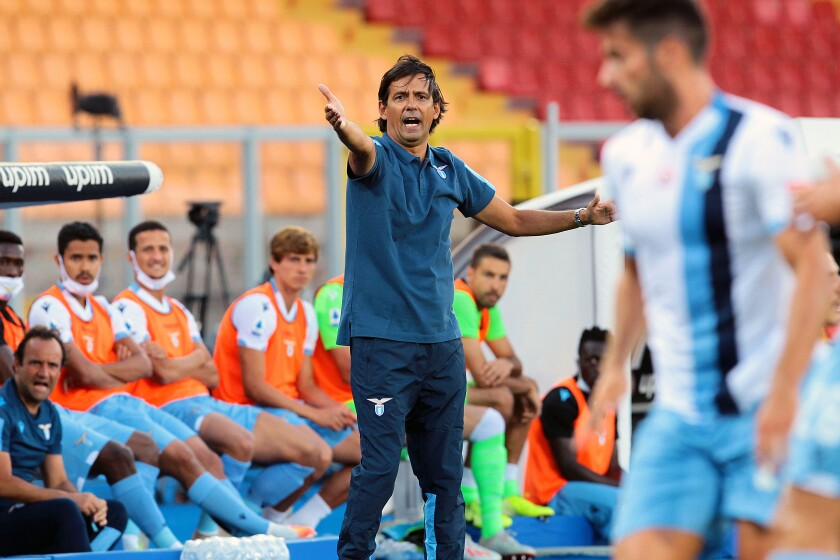 Lazio coach Simone Inzaghi gives instructions to his players during the Serie A soccer match between Lecce and Lazio at the Stadio del Mare in Lecce, Italy, Tuesday, July 7, 2020. (Donato Fasano/LaPresse via AP)