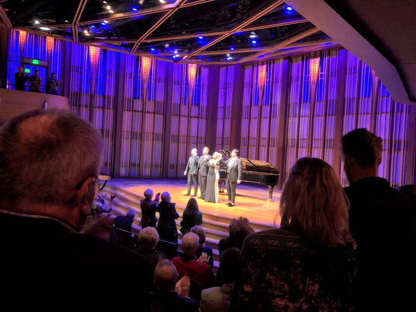 Pianist Christopher Allen, left, takes a bow to a standing ovation with Bel Canto Trio singers Nicholas Brownlee, Julie Adams and Joshua Guerrero Wednesday at a San Diego Opera recital at the Baker-Baum Concert Hall in La Jolla.